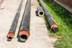 Close up of new insulated pipes for water district heating sewage or gas with insulation on the pipeline reconstruction site on th. E street in the city stock photo