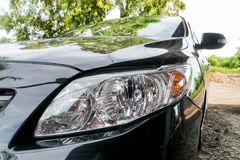 Close up new LED headlight of the car. Close up new LED headlight of the black car Royalty Free Stock Photo