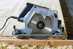 Close-up of new modern powerful circular electrical saw cutting royalty free stock photography