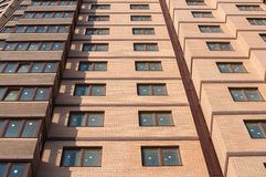 Close-up of a new multi-storey building. Brown wall of a block of flats close-up Royalty Free Stock Photos