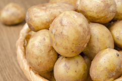Close-up of new potatoes in the basket, selective focus Stock Image