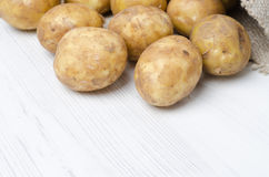 Close-up of new potatoes in a sack on a white background Royalty Free Stock Images
