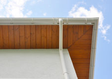 Close up on New Rain Gutter, Downspout,  Soffit Board, Fascia Board Installation. Against Blue Sky Royalty Free Stock Photos