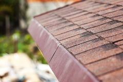 Close up of new roof with asphalt shingles. Close up of new roof with asphalt shingles royalty free stock photography