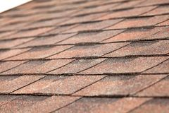Close up of new roof with asphalt shingles. Close up of new roof with asphalt shingles royalty free stock images