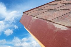 Close up new roof with asphalt tile under construction. royalty free stock images