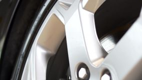 Close up of a new, silver car rim. Stock. New rim and car alloy wheel. Close up of a new, silver car rim. New rim and car alloy wheel stock video footage