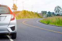 Close up of new silver hatchback car parking Stock Photos
