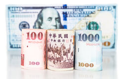 Close up of New Taiwan currency note against US Dollar Royalty Free Stock Image