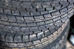 Close-up of a new tire tread. Winter tires piled on a pile close-up of a new tire tread stock photo