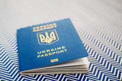 Close up of new ukrainian blue international biometric passport with identification chip on white and blue background with copy sp. Ace. Selective focus Royalty Free Stock Images
