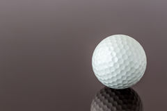 Close up the new white golf ball with the reflection, sport conc Stock Image