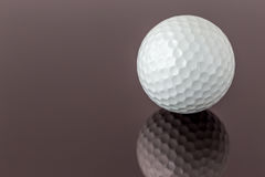 Close up the new white golf ball with the reflection, sport conc Royalty Free Stock Photos