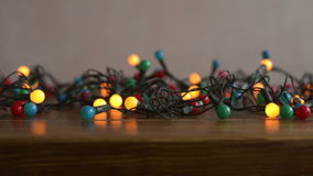 Close up of a New Year decoration. Twinkling on a wooden table. Shot with soft focus stock video