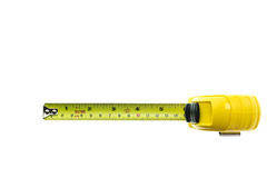 Close up new yellow measuring tape isolated on white Stock Photo