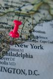 Close up of New York pin pointed on the world map with a pink pushpin. Capital city of America royalty free stock photo