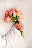 Close-up of newborn baby hand with flowers Stock Photo
