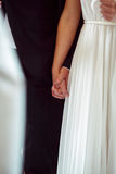 Close-up of newlweds hands holding each other tightly Royalty Free Stock Photo