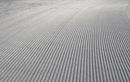 Close up of newly groomed slope. Close up of newly groomed backlit slope Royalty Free Stock Images