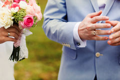 A close-up of newlyweds hands with rings Stock Photos