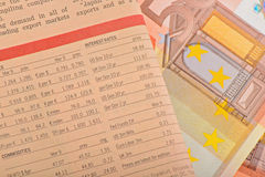 Close-up newspaper with of Euro banknotes Royalty Free Stock Image