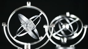 Close up of Newton's Cradle, Desk toy pendulum being activated, black background stock footage