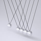 Close up of Newton's cradle Royalty Free Stock Image