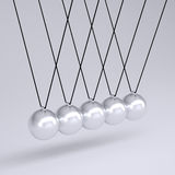 Close up of Newton's cradle Royalty Free Stock Images