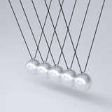 Close up of Newton's cradle Royalty Free Stock Photography