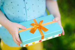 Close-up of nicely wrapped gift being held by a child with no face visible Stock Photos