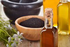 Close-up of nigella sativa oil. Royalty Free Stock Image