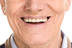 Close-up no sorriso alegre do homem superior fotografia de stock royalty free