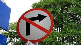 Close up no turn right sign. With the tree stock images