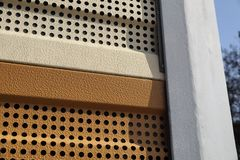Protection of residents against noise generated by vehicle traffic. Close-up of noise-absorbing protective panels royalty free stock photography