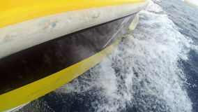The yacht nose. Close-up of the nose of a cutting wave yacht stock video