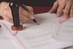 Close up on notaries public hand signing the testament Royalty Free Stock Images