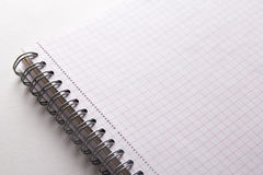 Close up of note book with checked pages Stock Images