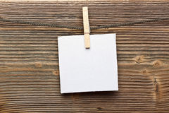 Close up of a note and a clothes peg Royalty Free Stock Image