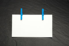 Close up of a note paper and clothes pegs Stock Photo