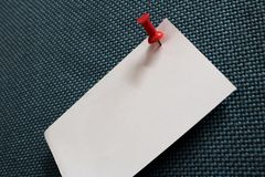 Close-up note paper and many colors pushpin into blue corkboard stock photography