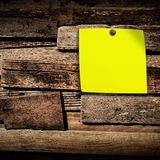 Close up of note paper on wooden background,Old wood background Royalty Free Stock Photos