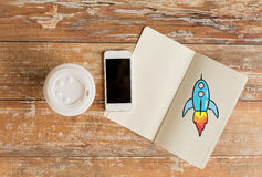 Close up of notebook, coffee cup and smartphone Stock Images
