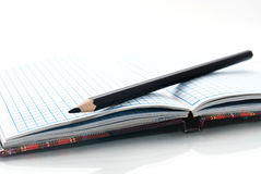 Close up of notebook and pencil Stock Photo