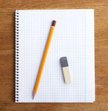 Notebook with pencil and eraser Royalty Free Stock Photo