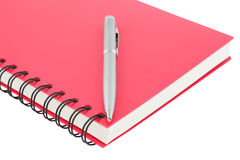 Close up notebook spiral bound and pen on white background Royalty Free Stock Photo