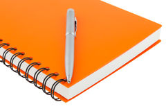 Close up notebook spiral bound and pen on white background Royalty Free Stock Images
