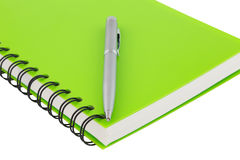 Close up notebook spiral bound and pen on white background Stock Images