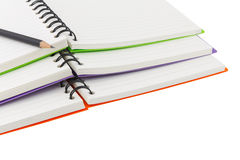 Close up  notebook spiral bound and pencil on white background Stock Photos