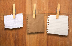 Close up of a notes and a clothes pegs Royalty Free Stock Images