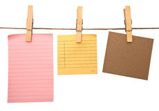 Close up of a notes and a clothes pegs Stock Images